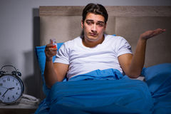 The man taking medical pills from insomnia Stock Image