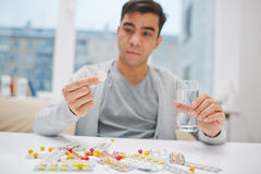 Man taking medications Stock Image