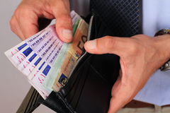 Man taking money out of wallet full of euro banknotes. Success, investment, business, financial growth, profit, dividends concept Royalty Free Stock Photos