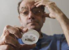 Man taking multiple pills Stock Image