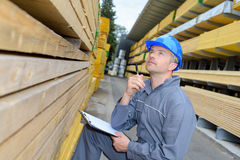 Man taking note in warehouse. Man taking a note in the warehouse Stock Photo