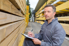 Man taking note in warehouse. Man taking a note in the warehouse Royalty Free Stock Images