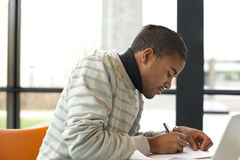 Man taking notes for his study Stock Photography