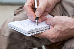 Man taking notes on a pocket book Royalty Free Stock Photo