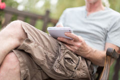 Man taking notes on a pocket book Stock Images