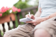 Man taking notes on a pocket book Stock Photos