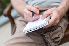 Man taking notes on a pocket book Royalty Free Stock Photography