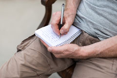 Man taking notes on a pocket book Royalty Free Stock Images