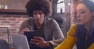 Man taking notes with woman hands in foreground.Group of multiethnic casual dressed people having business team informal stock video footage