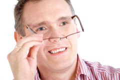 Man taking off glasses Stock Photos