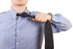Man taking off neck tie Royalty Free Stock Photography