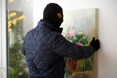 Man taking off painting Royalty Free Stock Image