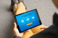 Man taking online courses, e-learning concept stock photography