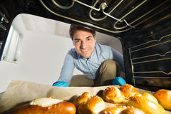 Man Taking Out Bread View From Inside The Oven Stock Image