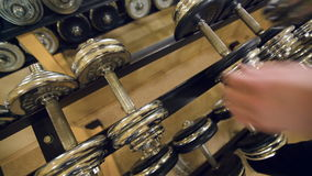 Man taking out dumbbell stock footage