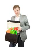 Man is taking out present box from case Stock Photos