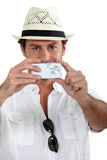 Man taking a photo. With digital camera stock image