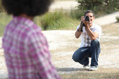 Man taking a photo Stock Image
