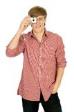 Man Taking a Photo. Young man taking a photo with a digital camera royalty free stock image