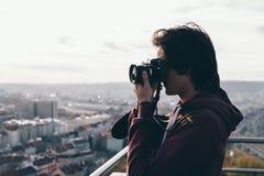 Man taking photo on balcony Stock Photos
