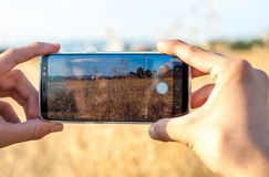 MAN TAKING A PHOTO WITH MOBILE PHONE stock photo