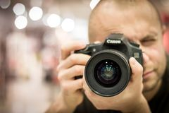 Man Taking Photo With Canon Black Camera Royalty Free Stock Images