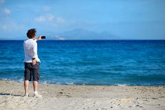 Man taking photo with cell phone on the beach Royalty Free Stock Photo