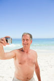 Man taking a photo of himself Royalty Free Stock Images