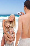 Man taking a photo of his family Stock Images