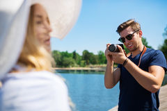 Man taking a photo of his female friend Stock Photo