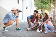Man taking photo of his friends Stock Images
