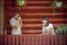 Man taking photo of his girlfriend Stock Image