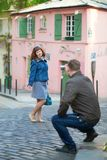 Man taking photo of his girlfriend in Paris Stock Photos