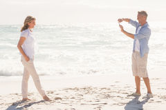 Man taking a photo of his smiling partner Royalty Free Stock Photography