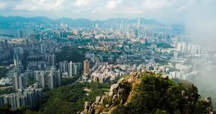 Man taking photo of Hong Kong cityscape from the Lion rock. Aerial view stock video footage