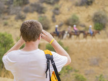 Man taking photo of Horseback riding in Hollywood Hills trail Stock Photos