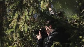 Man taking photo. With professional camera stock footage
