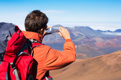 Man taking photo with phone. Man taking a photo of the mountains with smartphone Stock Photos