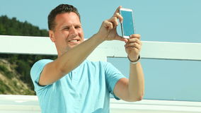 Man taking photo with smartphone Royalty Free Stock Image