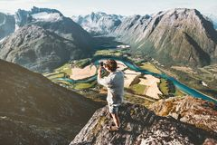Man taking photo by smartphone standing on cliff Stock Photography