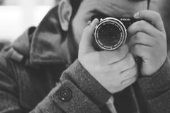 Man Taking Photo Using Black Dslr Camera Stock Photos