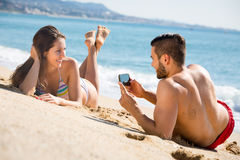 Man taking photo of woman on beach Royalty Free Stock Image