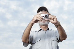 Man taking a photograph Stock Photo