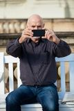 Man taking a photograph with his mobile Royalty Free Stock Image