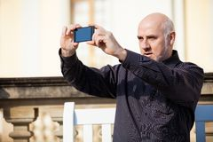 Man taking a photograph with his mobile Royalty Free Stock Photography