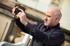 Man taking a photograph with his mobile Stock Photography