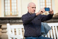 Man taking a photograph with his mobile Royalty Free Stock Images