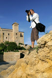 Man taking photograph of landscape Royalty Free Stock Photography