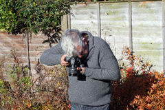 Man taking or shooting a photograph and pointing c Royalty Free Stock Photos