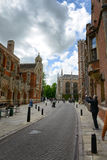 Man Taking Photograph of St Johns Divinity School Stock Image